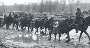 Mounted soldiers transporting shells to the front near Ypres, Belgium in 1917. Photograph: Fr Browne.