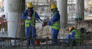 Migrant labourers work on a construction site last October in Doha in Qatar. Photograph: AFP