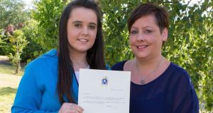 Nicole Kane with her Mum Marie and the letter she received from the Pope. Photograph: Thomas Nolan