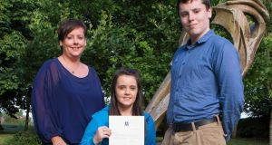 Nicole Kane with her Mum Marie and brother Adam and the letter she received from the Pope. Photograph: Thomas Nolan