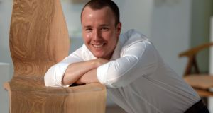 Enda Scott (30) wins RDS Award of Excellence for his Obliquity chair. Photograph: Dara Mac Dónaill / The Irish Times