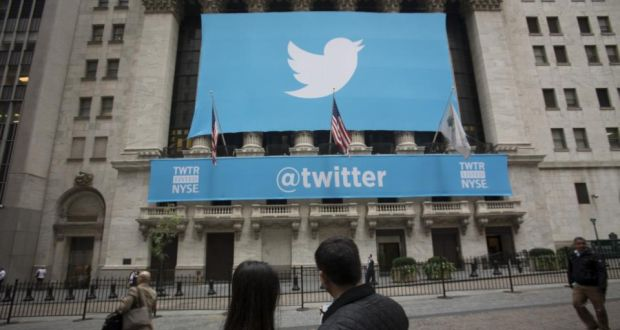 An @twitter banner is displayed on the exterior of the New York Stock Exchange. The microblogging company said revenue more than doubled to $312.2 million in the second quarter. Photo: Bloomberg
