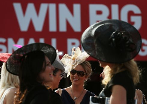 Racegoers enjoying day two of the Galway Festival at Galway Racecourse on Tuesday, July 29th, 2014. Photograph Brian Lawless/PA Wire