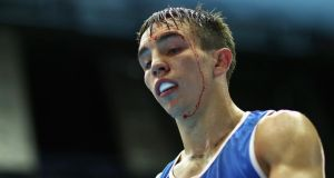 Michael Conlan has won a place in the Commonwealth Games semifinal. The Irishman had to be careful against Uganda's Bashir Nasir after getting cut in his first fight in an accidental clash of heads. Photograph: Richard Heathcote/Getty Images