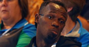 Usain Bolt of Jamaica  watches the netball match between Jamaica and New Zealand at the 2014 Commonwealth Games in Glasgow, Scotland. Photograph: Russell Cheyne / Reuters