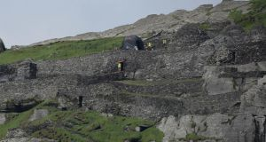 "'It takes a brave voice –  or three –  to question authorisation for activity which is said to have Portmagee ""buzzing"", which has the Naval Service patrol ship LE Samuel Beckett policing a two-mile exclusion zone at sea, and which will ensure that Skellig Michael becomes another ""cinema classic"" location.' Above, production crew and sets on Skellig Michael   as Star Wars Episode VII directed by JJ Abrams began filming earlier this week. Photograph: Charles McQuillan/Getty Images"
