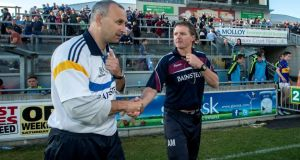 Tipperary manager Peter Creedon shakes hands with Galway manager Alan Mulholland after the qualifier in Tullamore. Photograph: James Crombie/Inpho