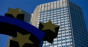 The headquarters of the European Central Bank (ECB) stands beyond a euro sign sculpture in Frankfurt, Germany. Euro-area inflation unexpectedly slowed in July to the weakest in almost five years, underscoring the ECB's concerns that the economy is too feeble to drive price growth. Photo: Bloomberg