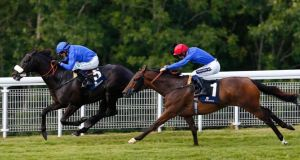 Kieren Fallon on Cavalryman (left) wins The Goodwood Cup ahead of Harry Bentley on Ahzeemah. Photograph: Eddie Keogh/Reuters