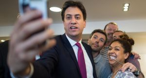Labour leader Ed Miliband taking a selfie recently in a hairdresser's in Cambridge city centre. Miliband's image is a problem for his party, as illustrated by his on-camera difficulties recently when he struggled to bite into a bacon sandwich. Photograph: Stefan Rousseau /PA