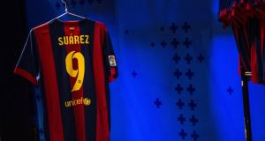 A Barcelona shirt featuring Luis Suarez's name at the club store earlier this month. Photograph: David Ramos/Getty Images