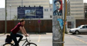 A sticker demanding asylum for US National Security Agency whistleblower Edward Snowden is seen outside the partially-finished new headquarters of Germany's Federal Intelligence Service. Photograph: Adam Berry/Getty Images