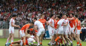 Armagh and Tyrone players confront each other en masse  early in the All-Ireland SFC   Qualifier Series Round 2B game at Healy Park in Tyrone. Photograph: Andrew Paton/Inpho/Presseye