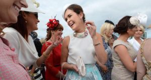 Helen Murphy from Douglas, Cork,   celebrating her  best-dressed win at Galway races yesterday.   Photograph: Cyril Byrne/The Irish Times