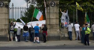 Protestors outside Glasnevin Cemetery during a ceremony attended by President Michael D Higgins and the Duke of Kent where they unveiled the Commonwealth Graves Commission Cross of Sacrifice. Photograph: Brenda Fitzsimons