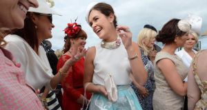 Helen Murphy from Douglas Cork celebrates her win as Best Dressed lady at Galway races yesterday. Photograph: Cyril Byrne /The Irish Times