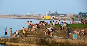 It was the brightest month for Dublin in almost three decades, as Dublin Airport station recorded its lowest number of dull days since 1990. Pictured are people enjoying the hot weather at Seapoint in Dublin last month. Photograph: Dave Meehan/The Irish Times