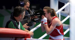Northern Ireland's Michaela Walsh kisses a tv camera after beating India's Pinki Rani in the women's flyweight semi-final at the Commonwealth Games in Glasgow. Photograph:  Peter Byrne/PA