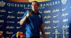 Richard Dunne gives a thumbs-up as he leaves a Queens Park Rangers press conference at Carton House in Maynooth. Photograph: Donall Farmer/Inpho