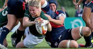 Ireland's Niamh Briggs stretches to score a try in the Women's World Cup Pool B game against the USA at Marcoussis in Paris. Photograph:  Dan Sheridan/Inpho