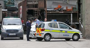The body parts are removed from the scene at the Thorntons Recycling plant on Kileen Road, Ballyfermot, this afternoon. Photograph: Colin Keegan/Collins