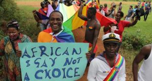 "Gay and lesbian activists attend a gay pride parade in Kampala. The Ugandan law struck down yesterday banned the ""promotion of homosexuality"" and enabled life sentences to be imposed for various same-sex acts, including touching in public or living in a same-sex marriage. Photograph: EPA/Rachel Adams"