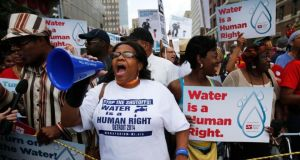 A protest against the mass water shut-offs in Detroit. Photograph: Reuters/Rebecca Cook