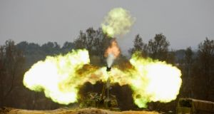 An Israeli mobile artillery unit firing towards the Gaza Strip yesterday. Photograph: Baz Ratner/Reuters