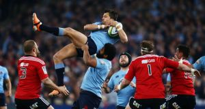 Adam Ashley-Cooper of the Waratahs jumps for a high ball during the Super Rugby Grand Final. Photograph:  Matt King/Getty Images