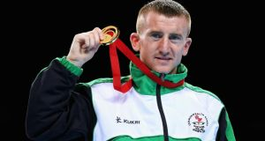 Gold medalist Paddy Barnes of Northern Ireland poses during the medal ceremony for the Men's Light Fly (49kg) Final in Glasgow. Photograph: Alex Livesey/Getty Images