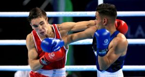 England's Qais Ashfaq (right) and Northern Ireland's Michael Conlan during the Men's Bantam (56kg) Final in Glasgow.  Photo Peter Byrne/PA Wire.