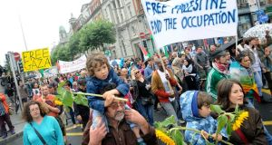 A march protesting the Israeli treatment of Gaza, organised by The Ireland Palestine Solidarity Campaign (IPSC) today, which started at the Garden of Remembrance and finished the Dept of Foreign Affairs on St Stephen's Green.  Pictured are Martin Whelan with his son Oisin (3). Photograph: Dave Meehan/The Irish Times