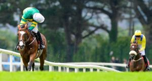 Marchese Marconi and Robbie Power  win the Ladbrokes Maiden Hurdle on day six of the Galway Festival. Photograph: PA Wire