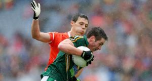 David Bray of Meath with struggles to find a way past James Morgan of Armagh at Croke Park. Photograph: Donall Farmer/Inpho