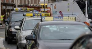 Taxis in central Dublin: According to the Irish Taxi Drivers' Federation, there is an attack on a driver every weekend. Photograph: Cyril Byrne