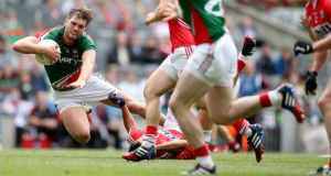Mayo's Aidan O'Shea tackled by Tomás Clancy, which resulted in the  Cork player receiving a black card. Photograph: James Crombie/Inpho