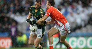 Meath's Michael Newman is tackled by Armagh's  Brendan Donaghy during the qualifer at Croke Park. Photo: Ryan Byrne/Inpho