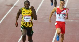 Jamaica's sprint superstar anchors the men's relay team to bring home gold at the 2014 Commonwealth Games in Hamden Park, Scotland . Photograph: Getty Images