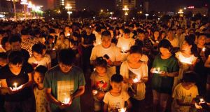 People attend a candlelight vigil for victims of a factory explosion in Kunshan, Jiangsu province REUTERS