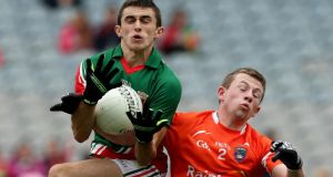 Mayo's Cian Healy battles with Fergus Quinn of Armagh at Croke Park during the minor quarter-final. Photo: Donall Farmer/Inpho