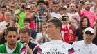 Real Madrid forward Cristiano Ronaldo, front centre, sits with team mates on the bench before the first half of the  International Champions Cup match with Manchester United at Michigan Stadium. Photograph: AP