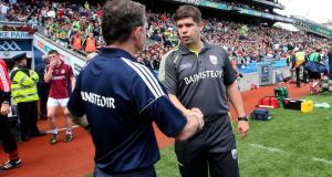 Galway manager Alan Mulholland and Kerry's Eamonn Fitzmaurice at the final whistle at  Croke Park yesterday. Photograph: James Crombie/Inpho