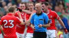 Cork's John Hayes, Paul Kerrigan, Colm O'Neill and Donncha O'Connor surround referee Cormac Reilly after the final whistle at Croke Park. Photograph: Cathal Noonan/Inpho