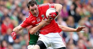 Mayo's Jason Doherty and Donncha O'Connor of Cork battle for possession in yesterday's All-Ireland quarter-final. Photograph: James Crombie/Inpho