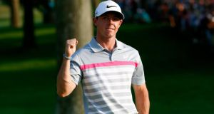 Rory McIlroy  celebrates after his winning putt on the 18th green in the  World Golf Championships-Bridgestone Invitational at Firestone Country Club South Course yesterday  in Akron, Ohio. Photograph: Sam Greenwood/Getty Images