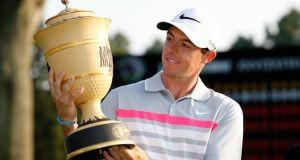 Rory McIlroy holds the Gary Player  trophy after winning the WGC-Bridgestone Invitational  at Firestone Country Club  in Akron, Ohio. Photograph: Gregory Shamus/Getty Images