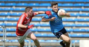 Dublin forward  Colm Basquel (right) tries to get past  Cian O'Donovan of Cork during the All-Ireland Minor Championship Quarter-final at Semple Stadium, Thurle. Photograph: Tommy Grealy/Inpho