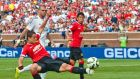 Manchester United forward Javier Hernández, front, and  midfielder Shinji Kagawa, right, in action at the  International Champions Cup in  Michigan last week, are interesting Atletico Madrid manager Diego Simeone. Photograph: Tony Ding/AP Photo