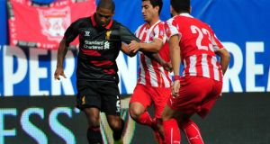 Liverpool's Glen Johnson in action against Olympiacos FC during the International Champions Cup on July 27th in Chicago. Photograph: David Banks/Getty Images.