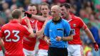 Cork players surround referee Cormac Reilly complaining that the official blew up too early in Sunday's All-Ireland quarter-final game against Mayo.